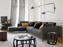 Glamorous-White-Living-Room-Color-Ideas-with-Black-Sectional-Sofa-and-Brown-Ottoman-Furnished-with-Round-Black-Table-Also-Completed-with-Gray-Window-Curtains-Ideas
