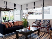 Smart-use-of-roman-shades-throughout-the-beach-style-living-room